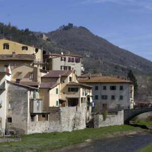 A view of the town and the bridge over the Comano